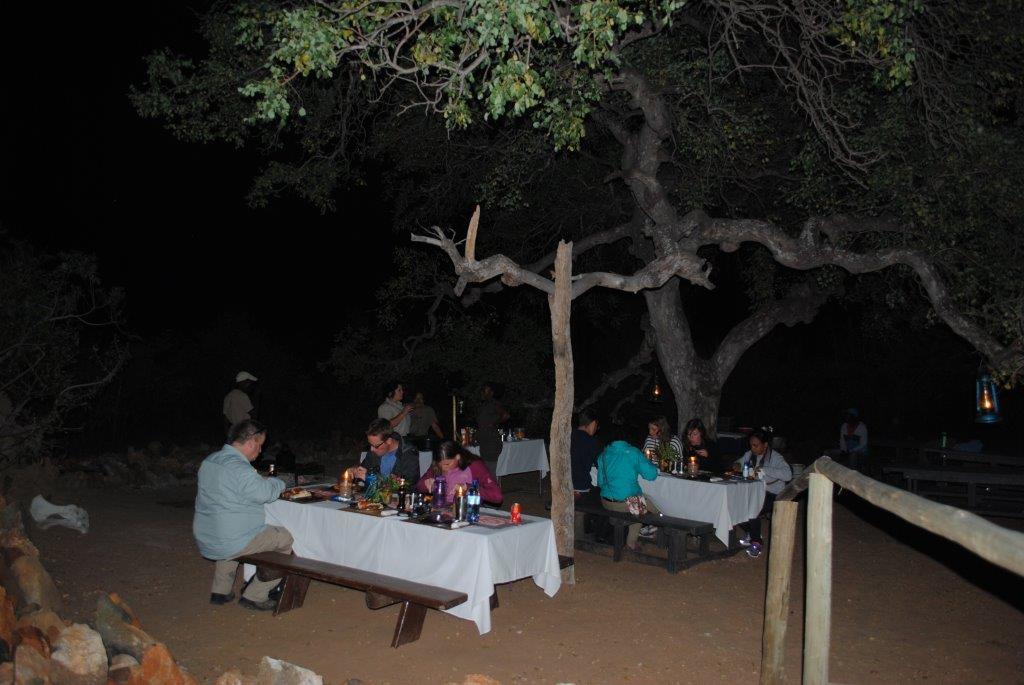 Guests enjoying the Marula Tree Boma bush braai