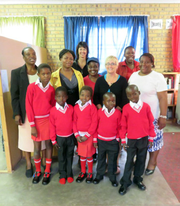 Volunteers with children in their new school uniforms at Funjwa Primary School