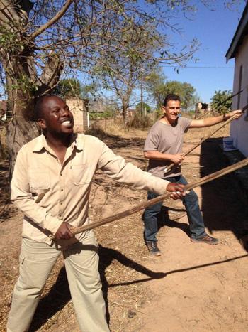 Bongani and Trevor painting the church wall