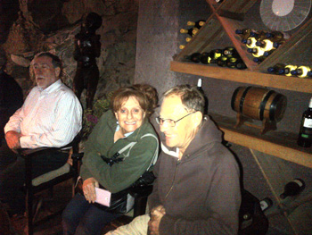 Sandra and Father Chris enjoy wine-tasting conducted by Laurence in the amazing cellar at Ezulwini