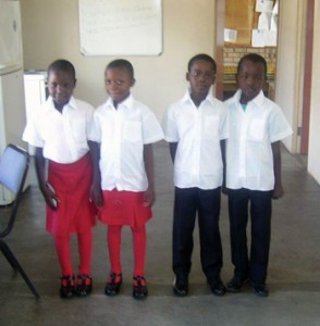 4 of the 125 lucky scholars with their brand new shoes.