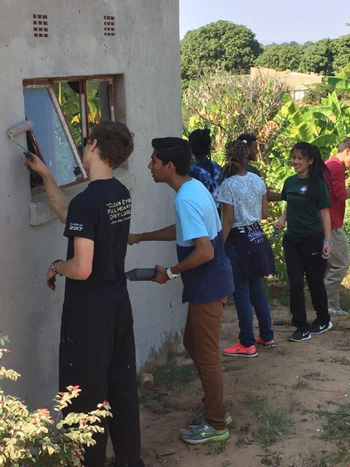 Students from MItty High paint Catholic Church in Acornhoek.