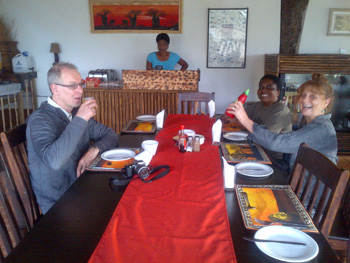 Sandy, Alice and Delina with guest appreciate new colourful table settings