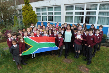 Pupils of St Andrew's School in Glasgow hand Cathy a cheque