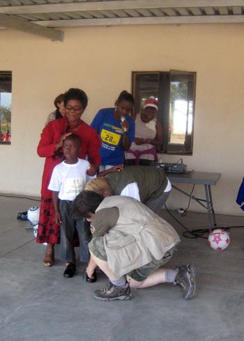 Volunteers with local children