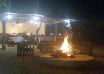 Big flames of fire around our little comfy boma.