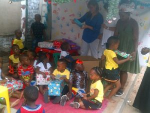 Sandra handing out Christmas presents to the children.