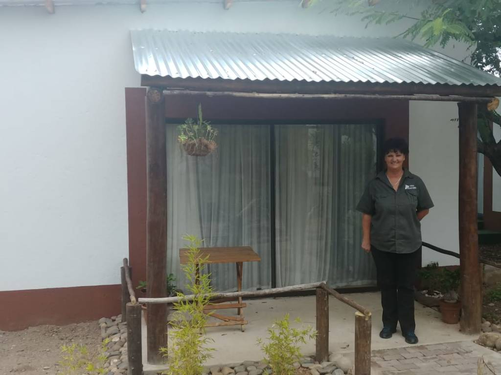Riana outside her new flatlet
